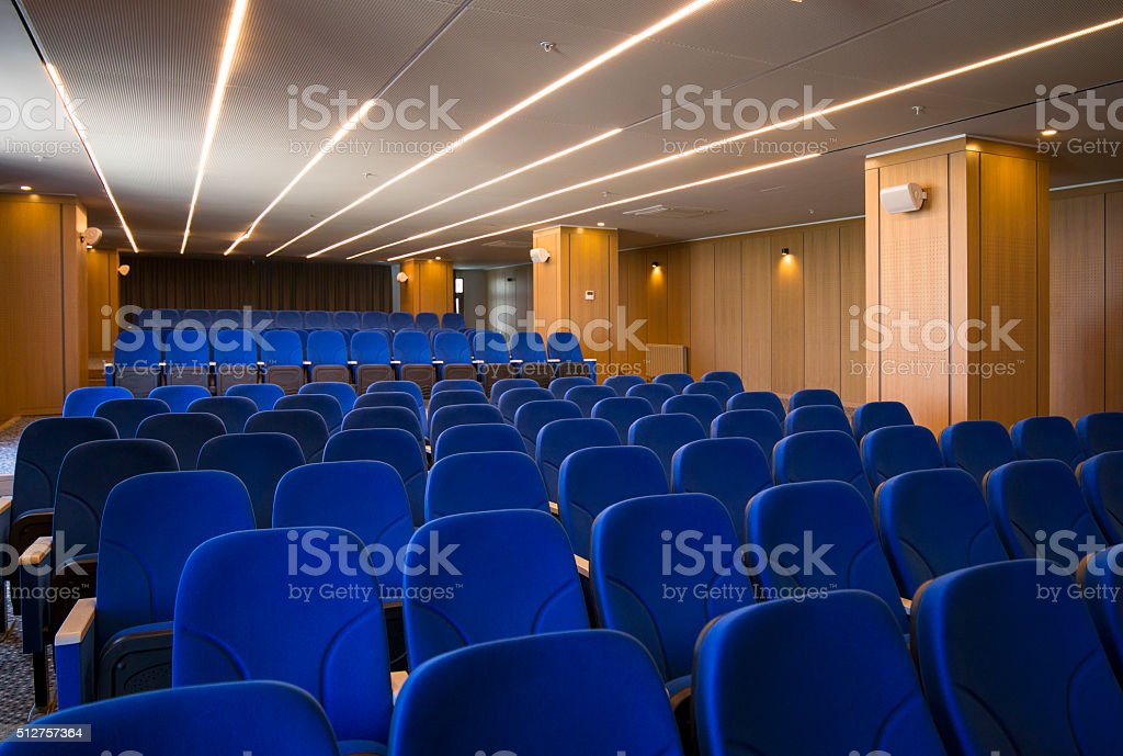 Empty chairs in a modern conference hall stock photo