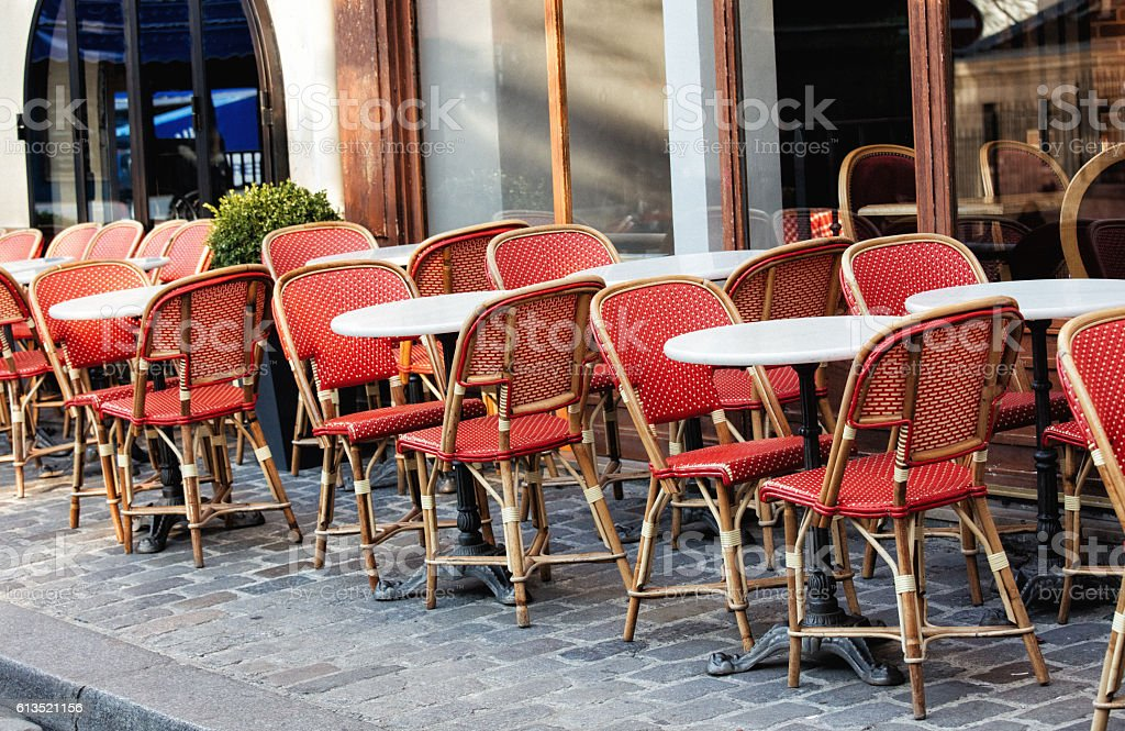 Empty chairs in a restaurant on the streets of Paris stock photo