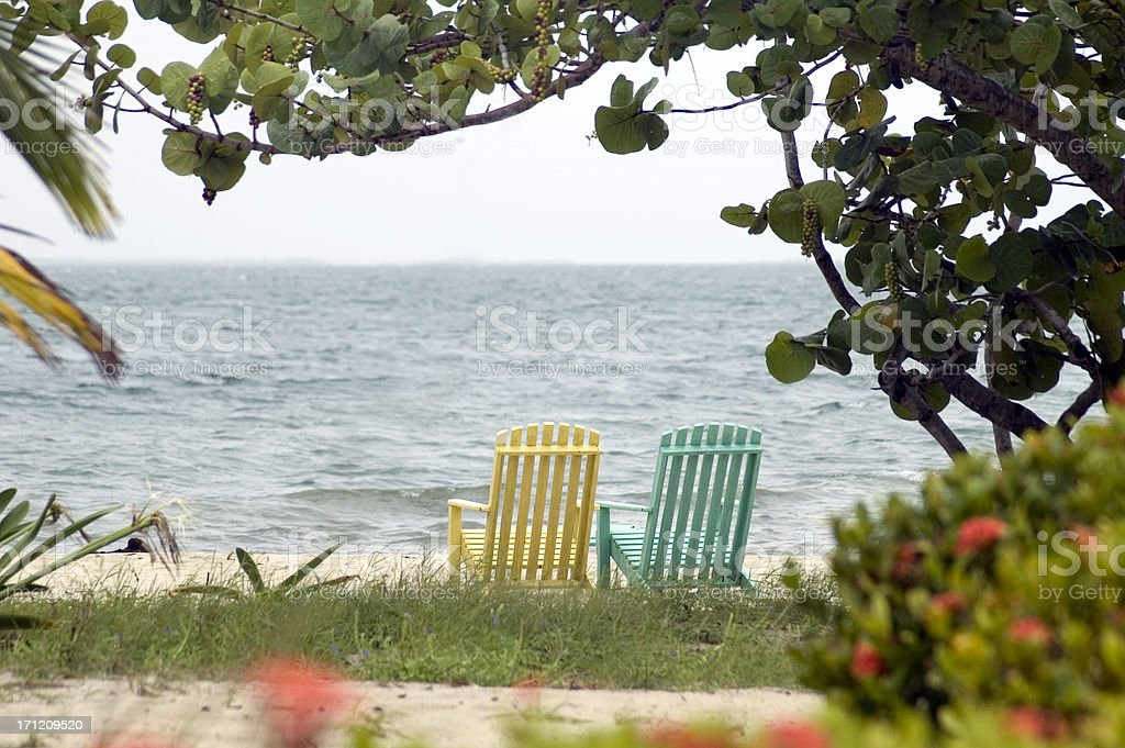Empty Chairs in Placencia stock photo