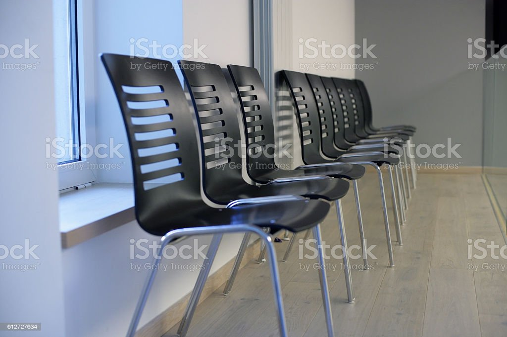 Empty chairs in row stock photo