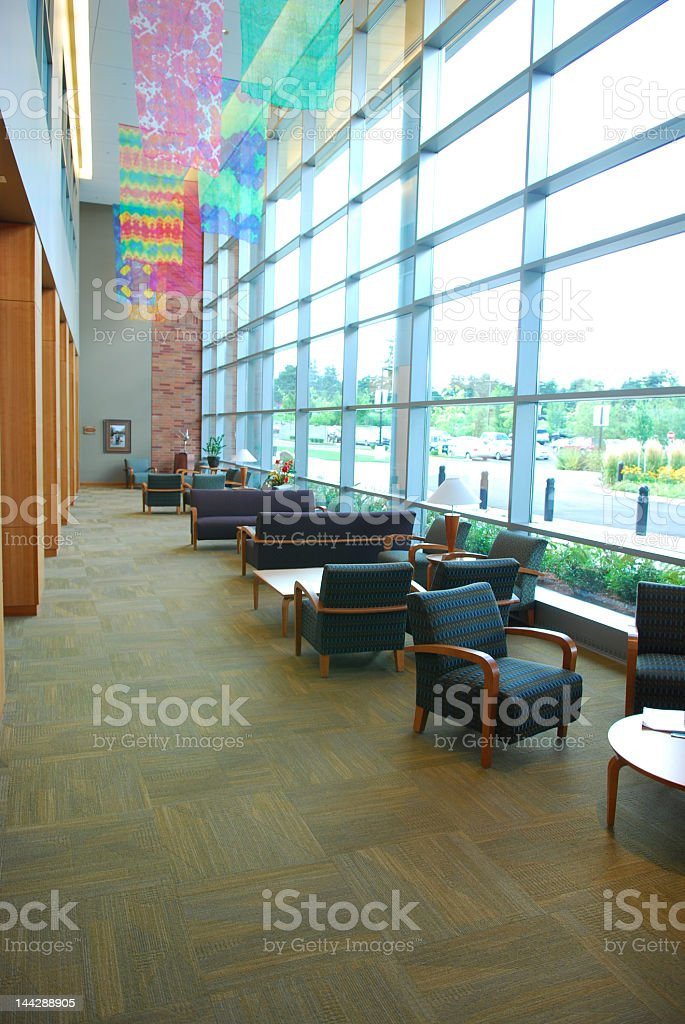 Empty chairs in waiting room with large windows royalty-free stock photo