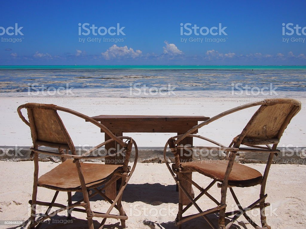 Empty chairs on tropical Indian Ocean beach stock photo