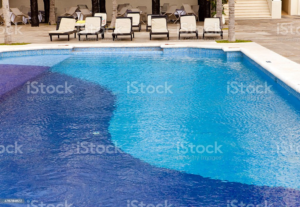 Empty chaise lounges near  pool stock photo