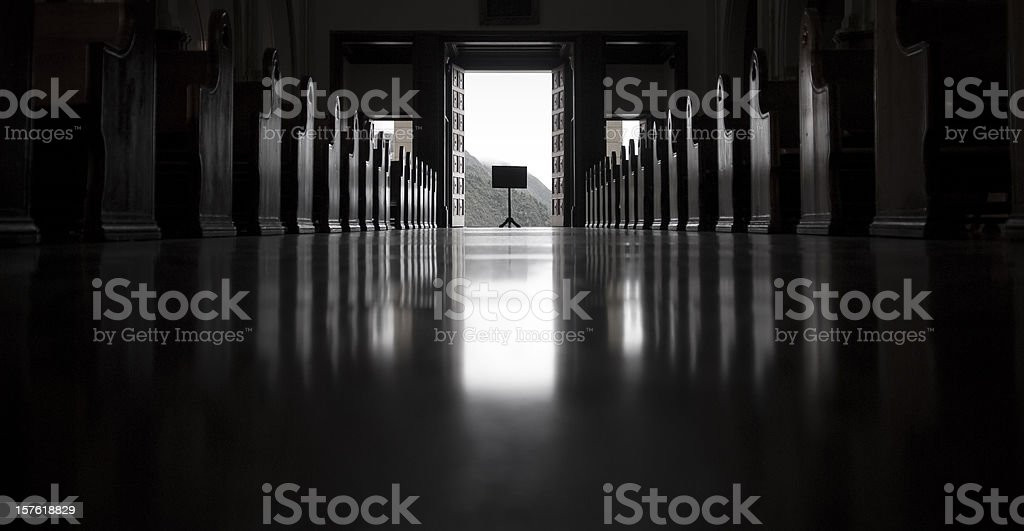 Empty Church, looking toward the open exit with sign royalty-free stock photo
