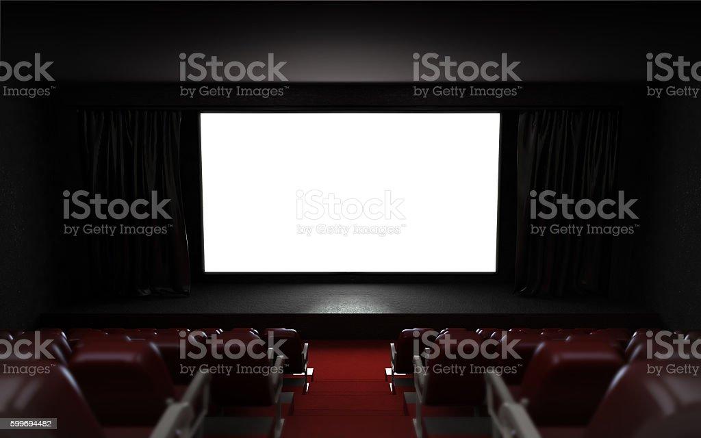 empty cinema auditorium with blank screen frame stock photo