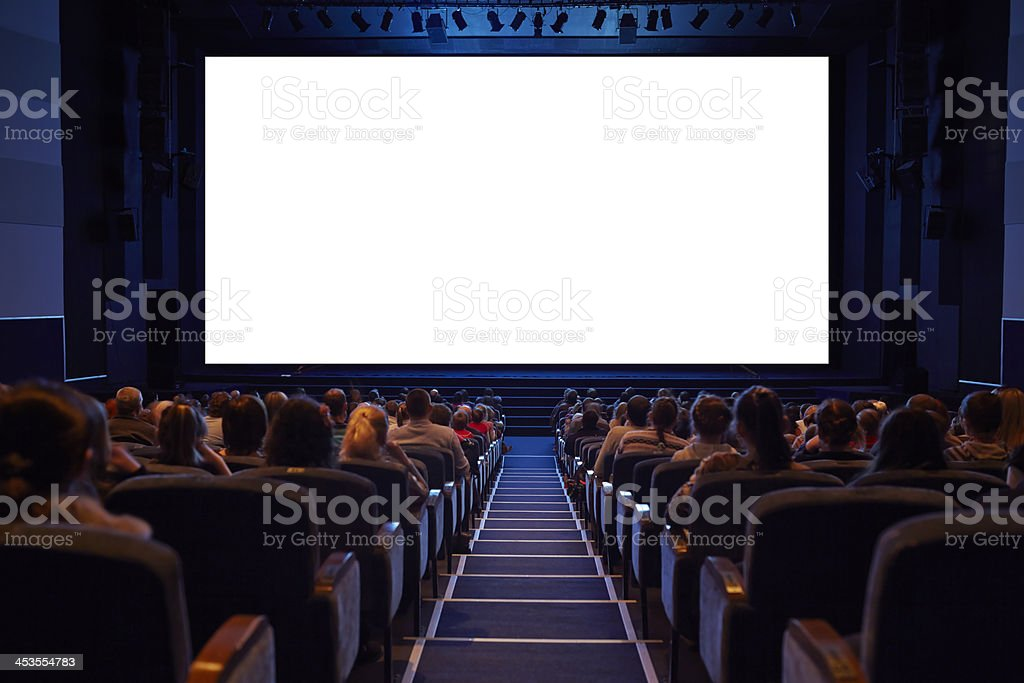 Empty cinema screen with audience. stock photo
