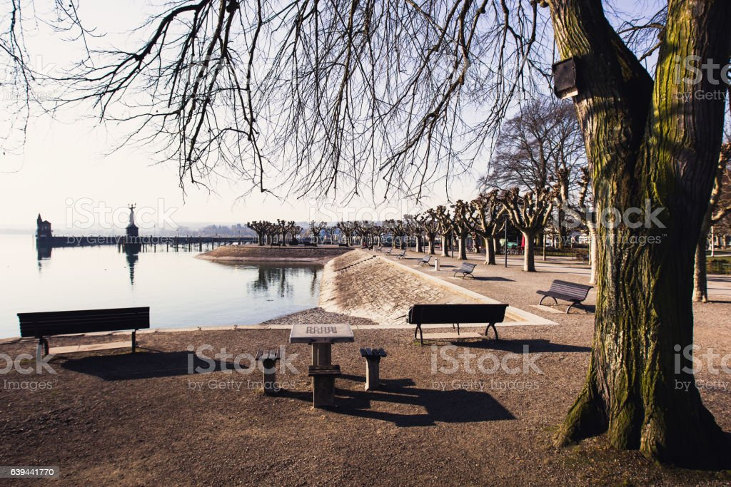 Empty city quay with tables for playing chess stock photo