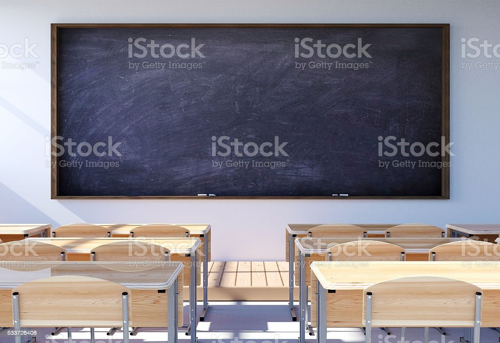 Empty classroom interior with student desk and chairs stock photo
