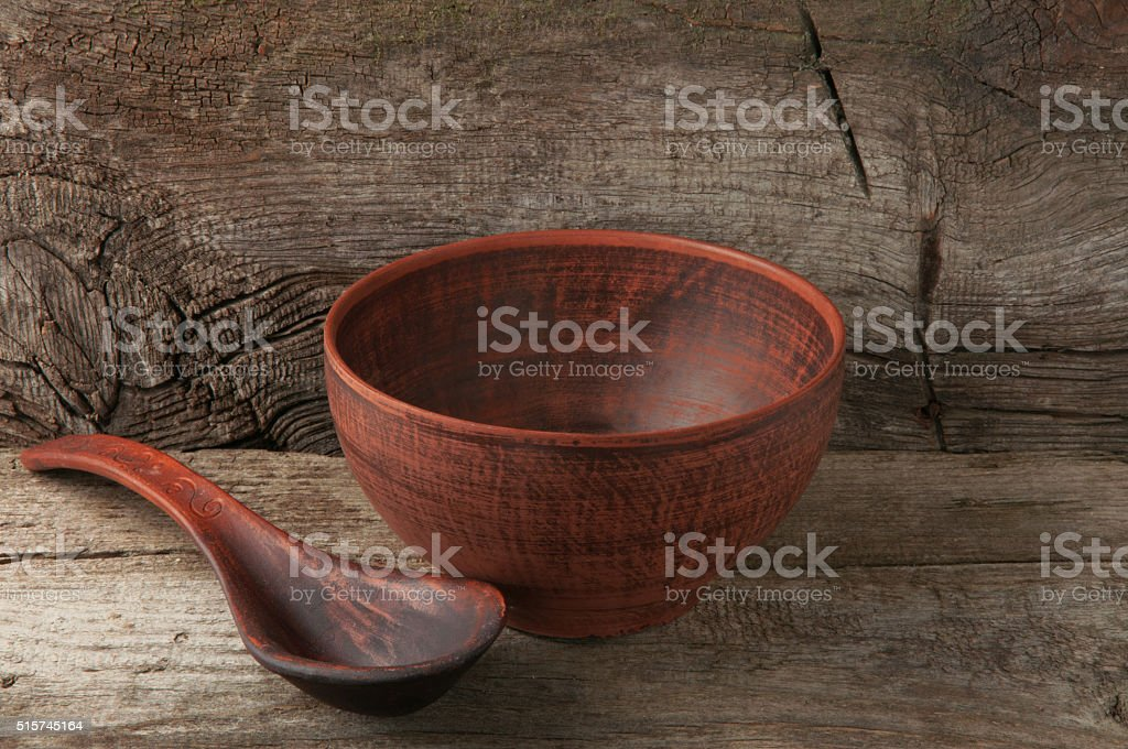 empty clay bowl with spoon stock photo