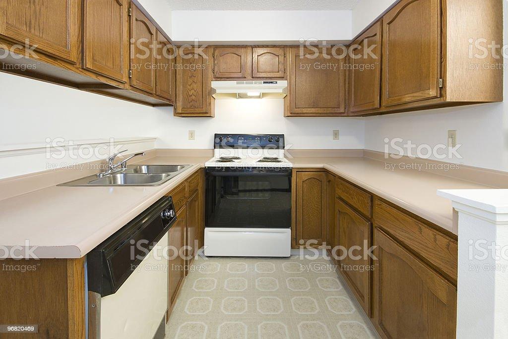 Empty clean older style kitchen area stock photo