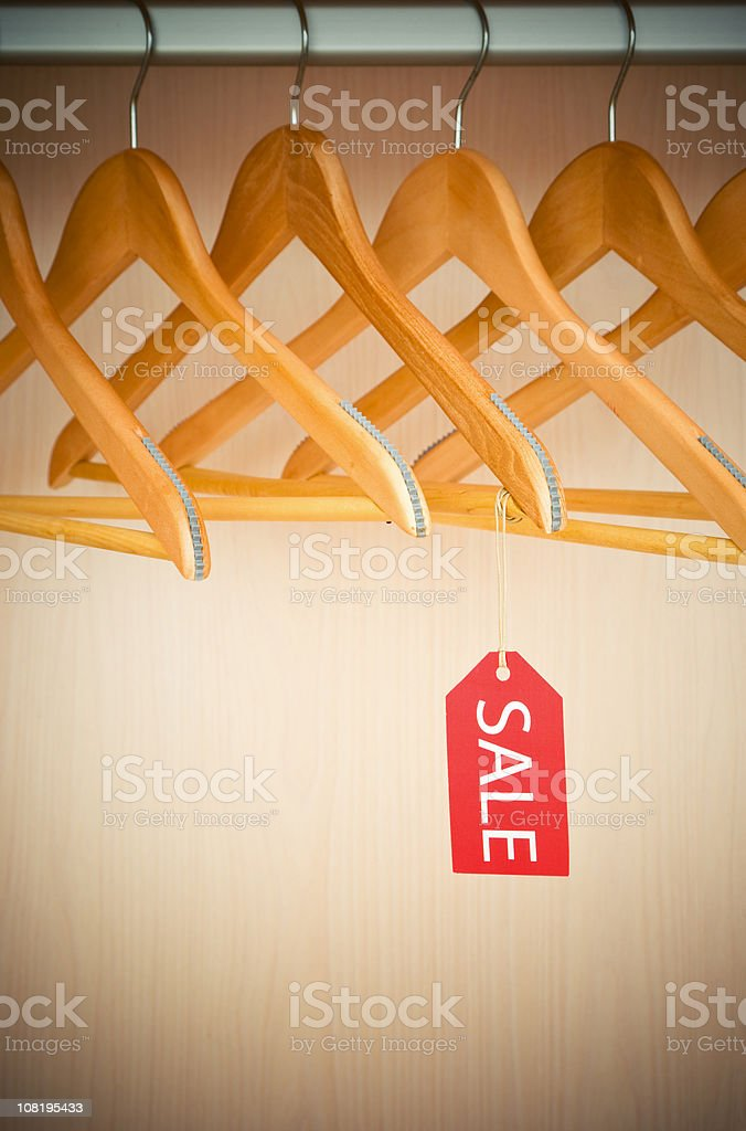 Empty Clothes Hangers with Sale Tag royalty-free stock photo