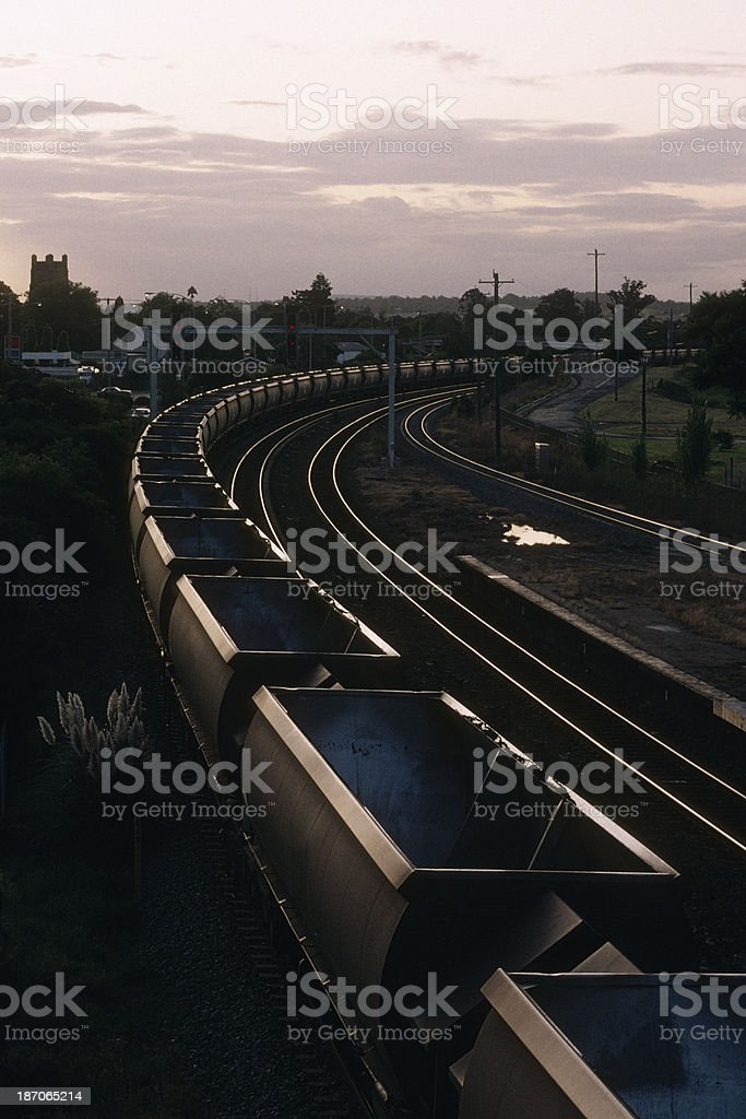Empty coal train at sunset royalty-free stock photo