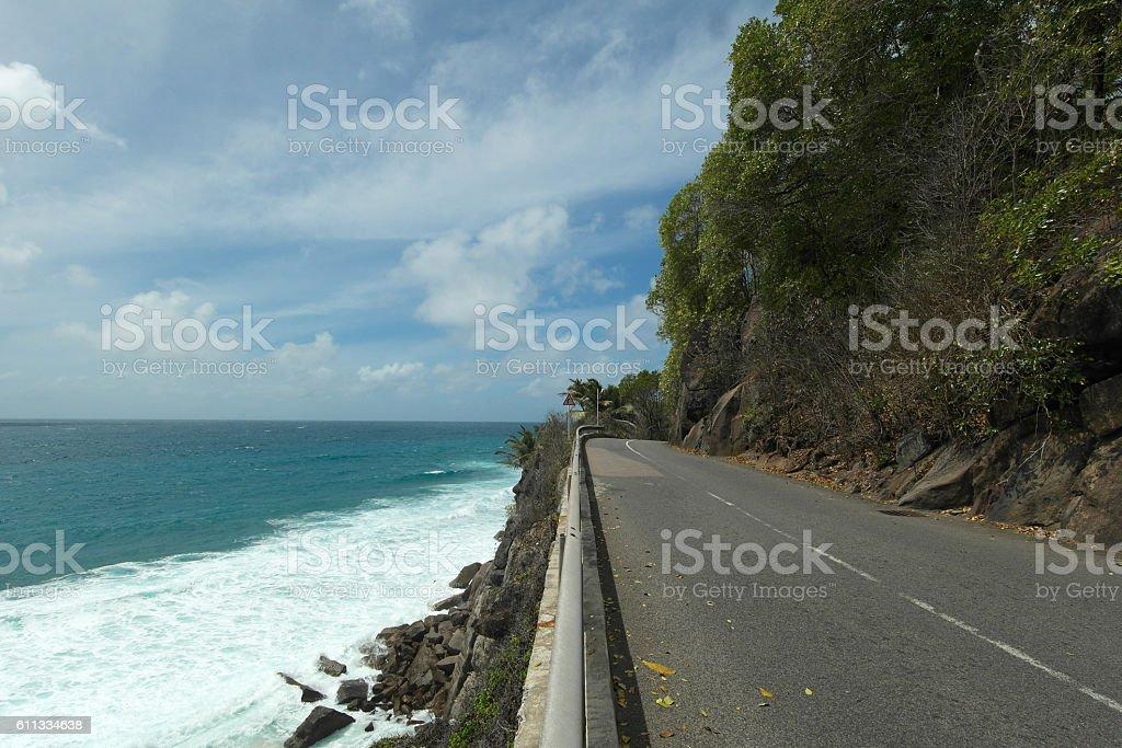 Empty coastal road on Mahe Island - Seychelles stock photo