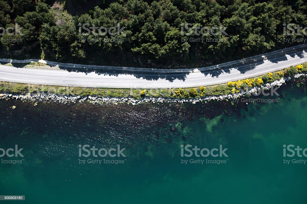 empty coastline with road aerial stock photo