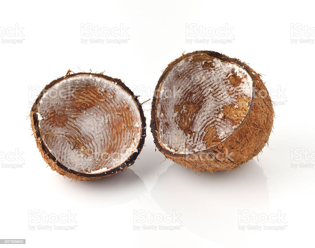 Empty Coconut Shells on White Background stock photo