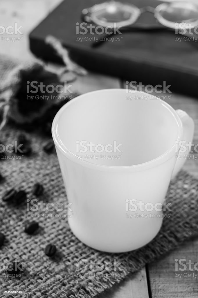Empty coffee cup and coffee beans on sackcloth mat, selection stock photo