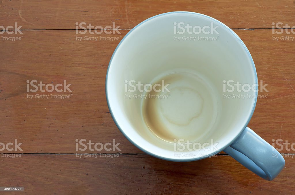 empty coffee cup on red wood table royalty-free stock photo