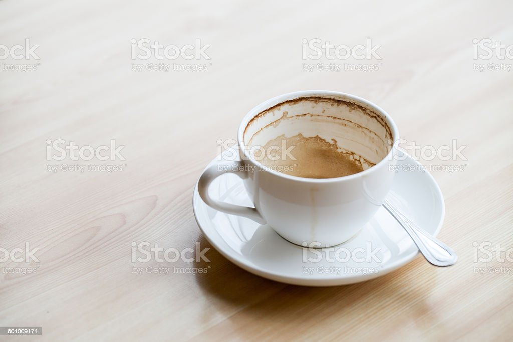 Empty coffee cup on the wooden table stock photo