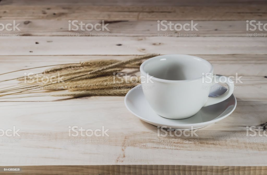 Empty coffee cup on wood background stock photo