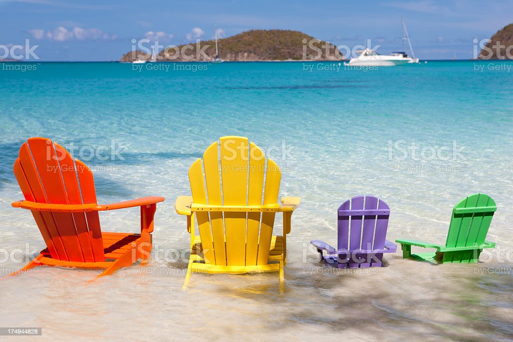 empty colorful andirondack chairs at a tropical beach royalty-free stock photo