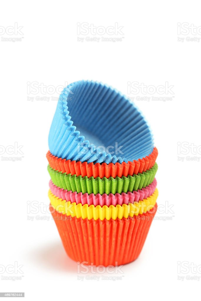 Empty colorful cupcake cases stock photo