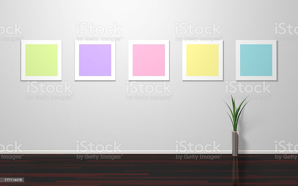 Empty colorful pictures on wall stock photo