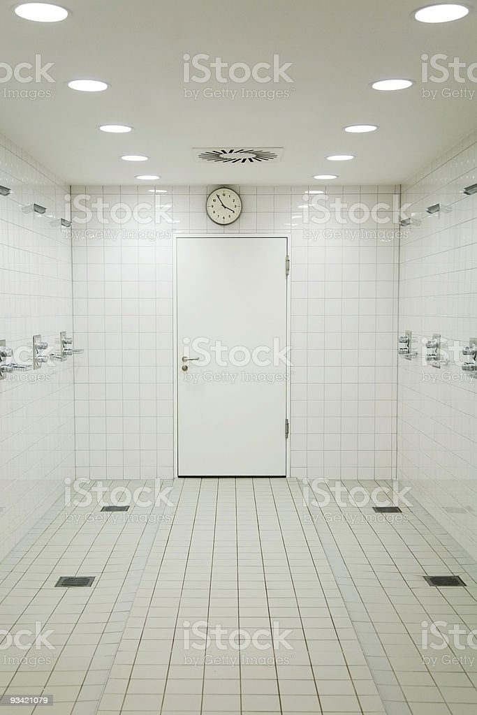 Empty communal shower room with white tiles and ceilings royalty-free stock photo