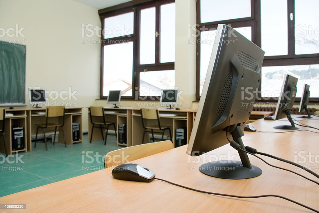 Empty computer classroom with rows of workstations royalty-free stock photo