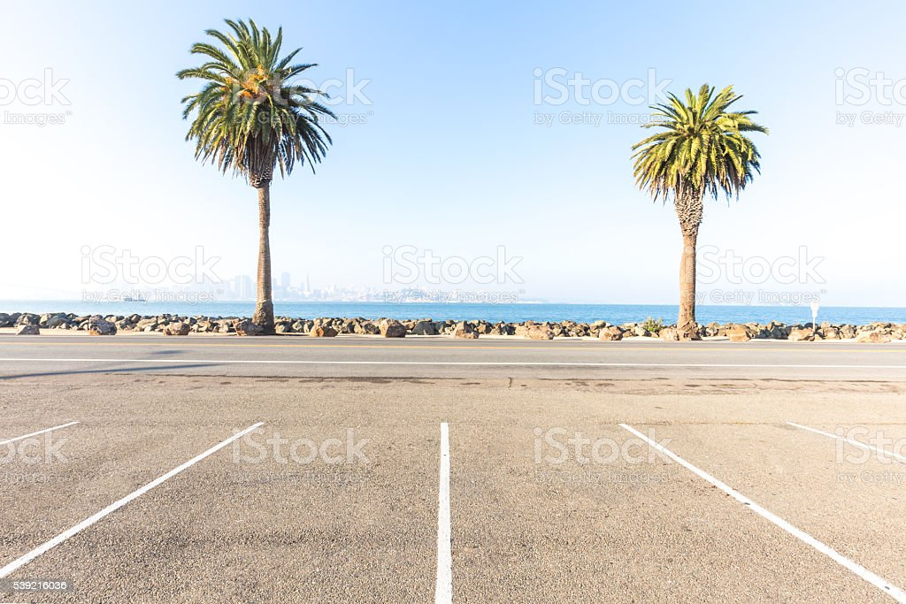 empty concrete road near water with cityscape of san francisco stock photo
