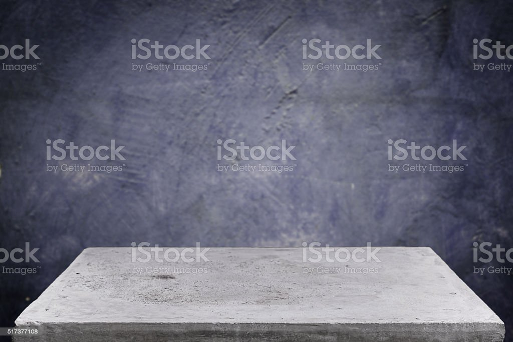 Empty concrete table top on grunge concrete background stock photo