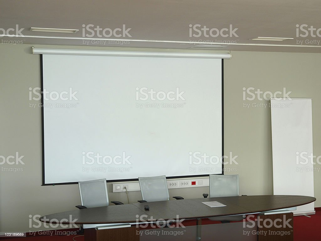 Empty Conference Room with Big Projection Screen stock photo