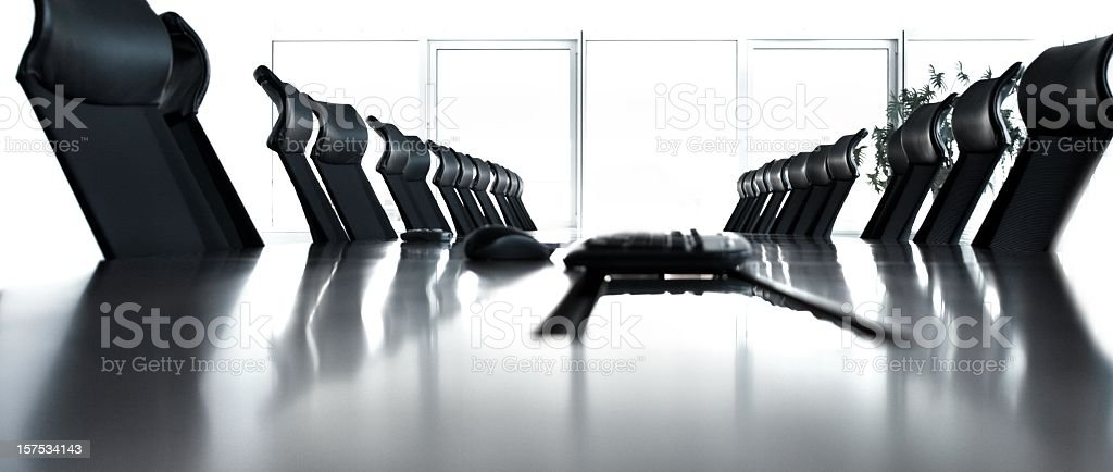 Empty conference room with black chairs in a row royalty-free stock photo