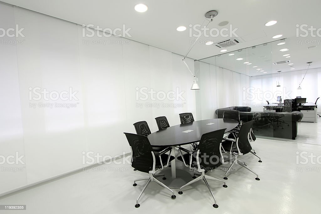 Empty conference room with black table and chairs stock photo