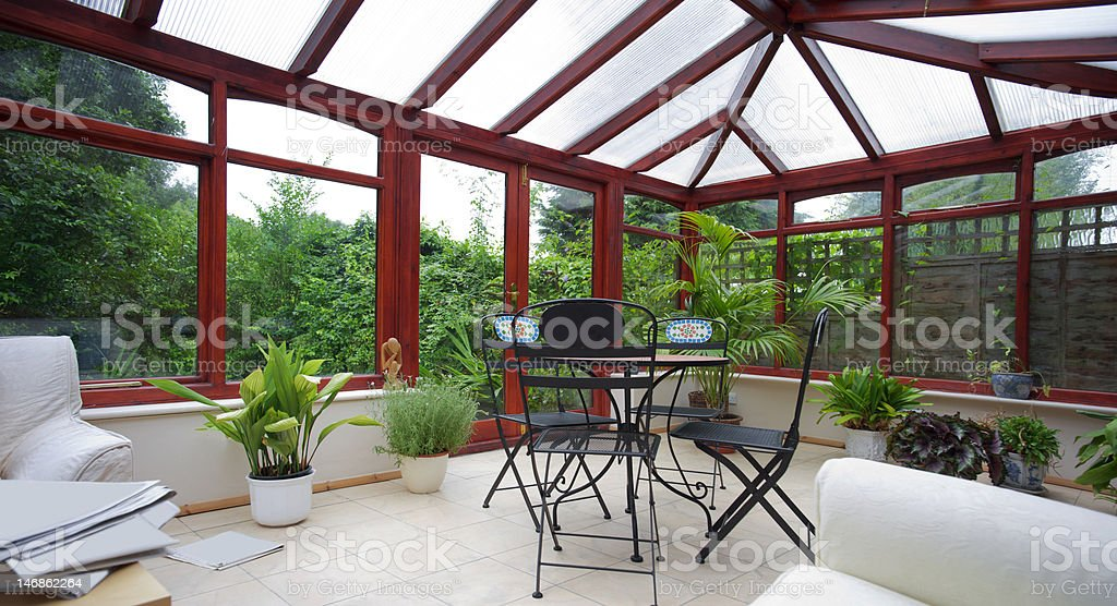 A empty conservatory with plans stock photo