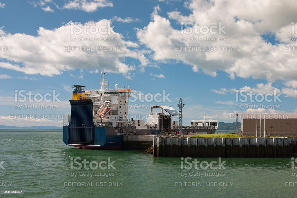 Empty container ship in Malbaie harbor, Canada. stock photo