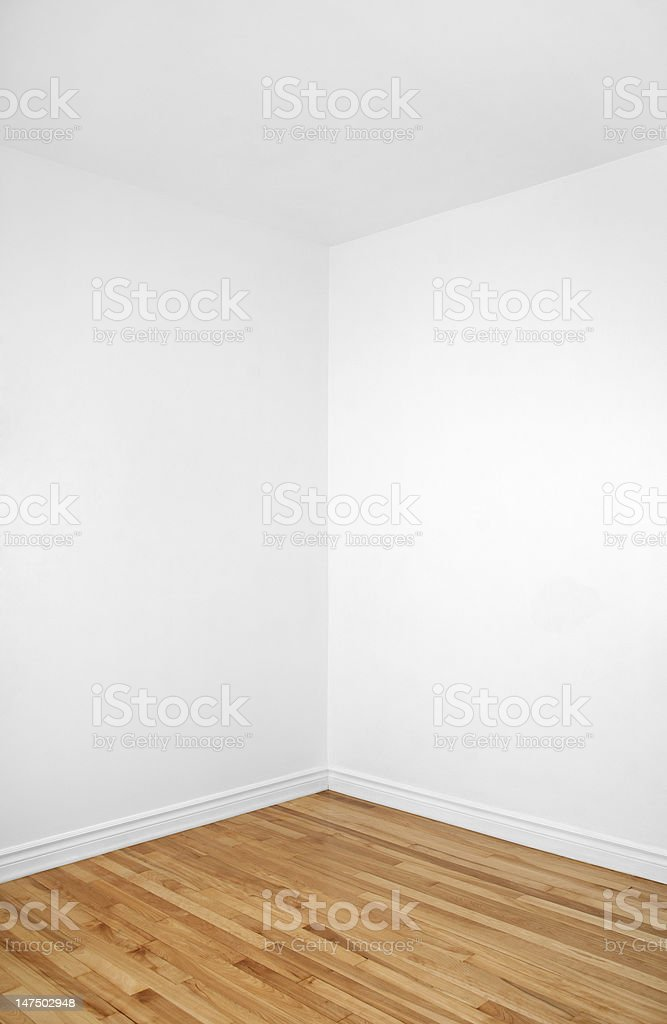 Empty corner of a room with wooden floor stock photo