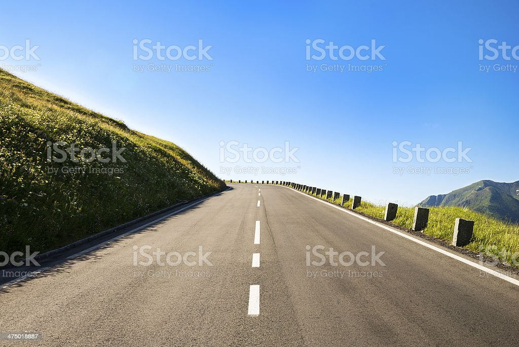empty country road with a sharp left curve stock photo