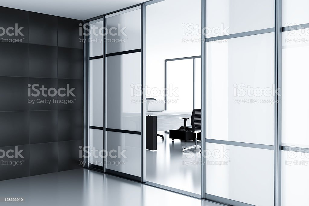Empty cubicle behind a glass doors stock photo