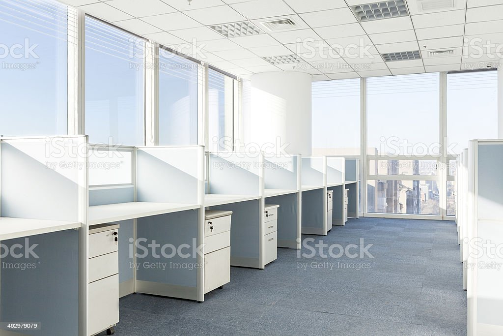Empty cubicles in a modern office building stock photo