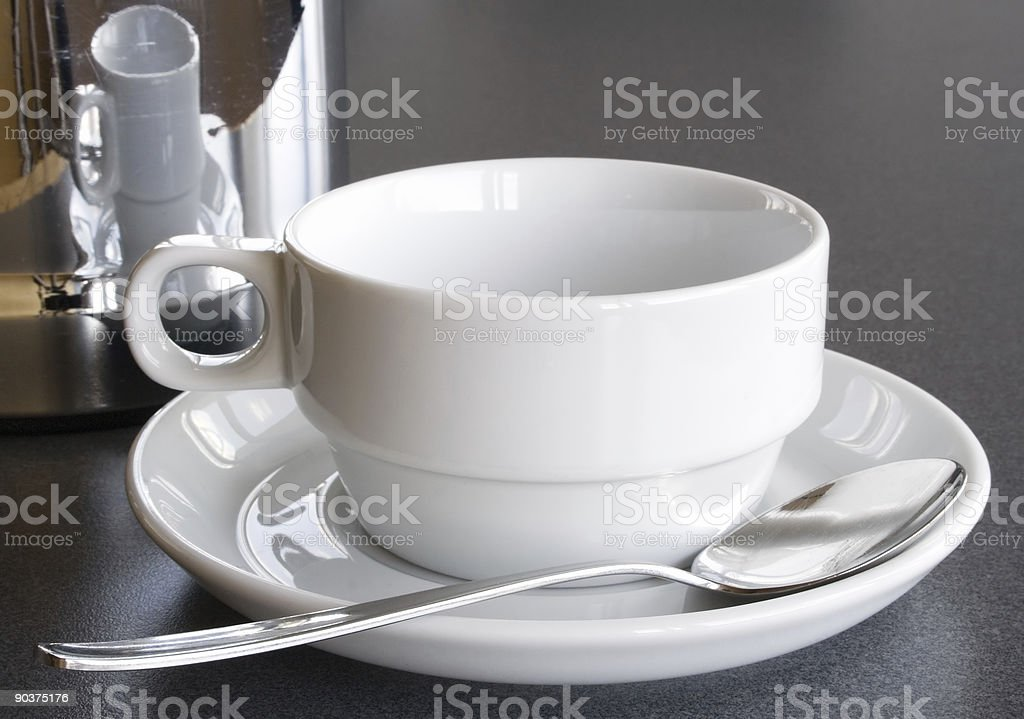 Empty Cup and Coffee Pot stock photo