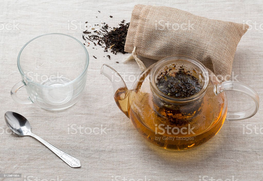 Empty cup and the teapot with freshly brewed tea stock photo