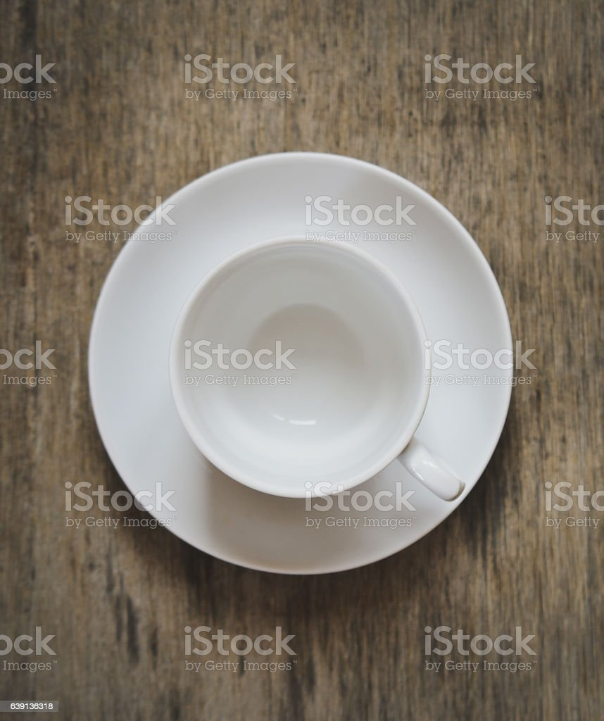 empty cup for coffee or tea on a plate stock photo