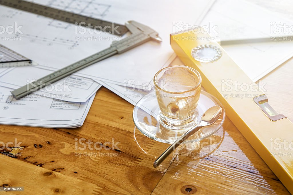 Empty cup of coffee and measurement tool with sun flare stock photo