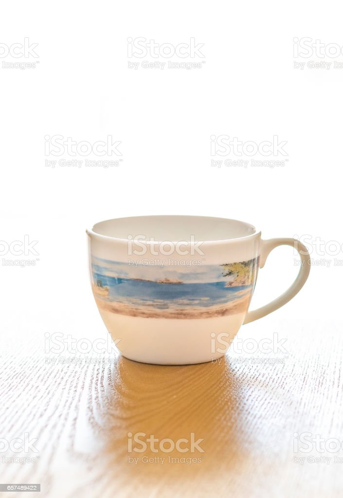 Empty cup of coffee or tea on table stock photo