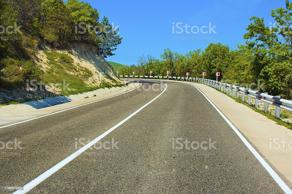 Empty curved road royalty-free stock photo