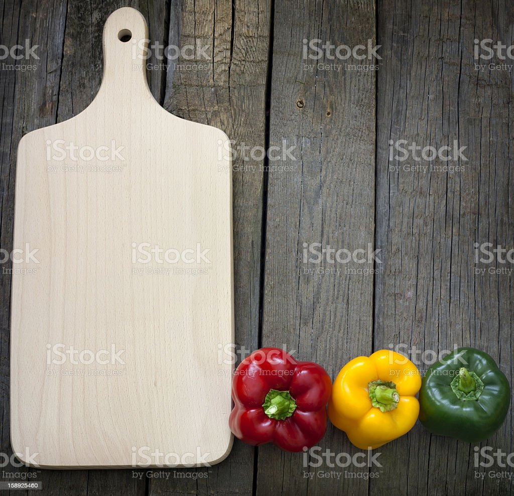 Empty cutting board and paprika abstract background royalty-free stock photo