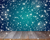 Empty deck on a blue background with flying snow.