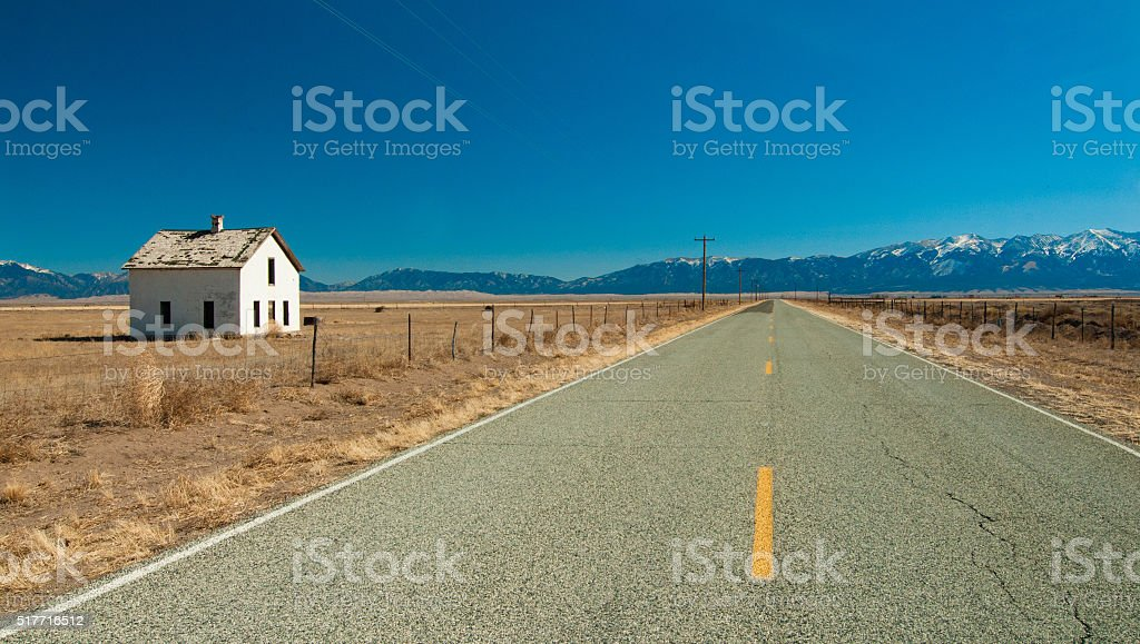 Empty Desert Road and Farm House stock photo