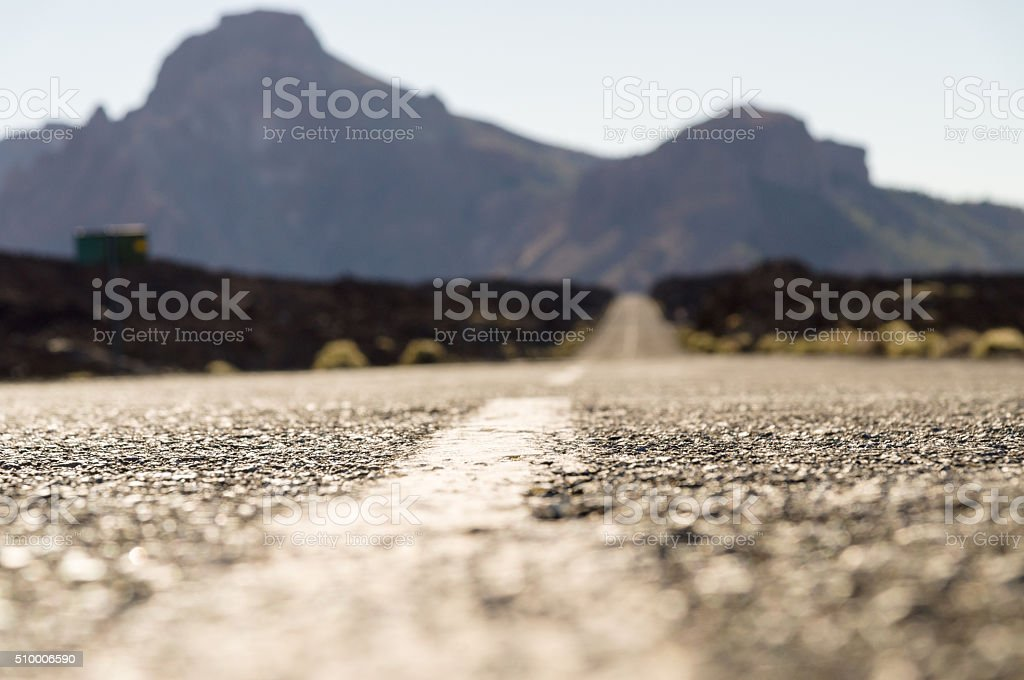 Empty desert road with mountains on background stock photo