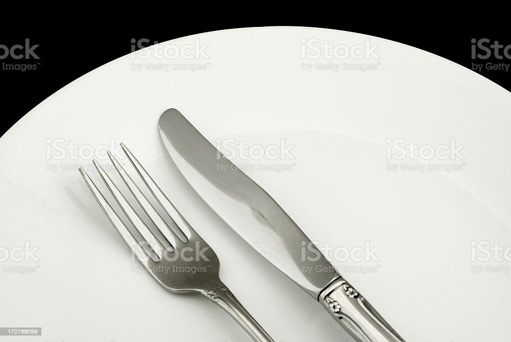 empty dinner plate with knife and fork royalty-free stock photo